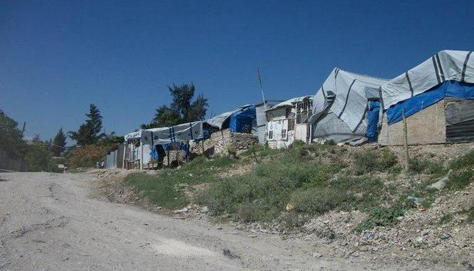 group of tarp covered shacks